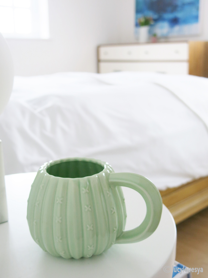 White bedroom green mug colour