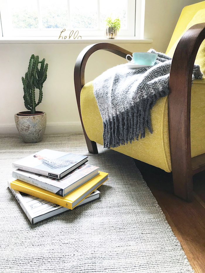 Cosy armchair yellow grey living room