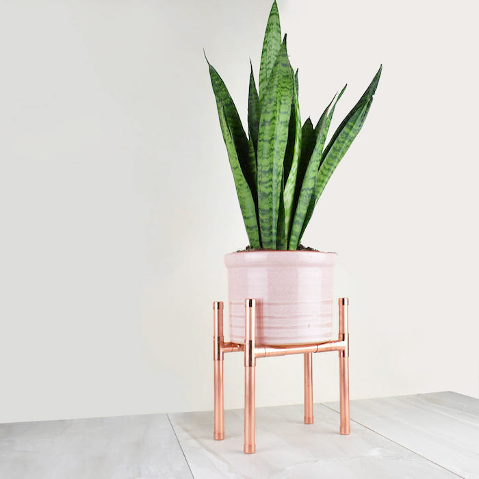 copper planter on legs