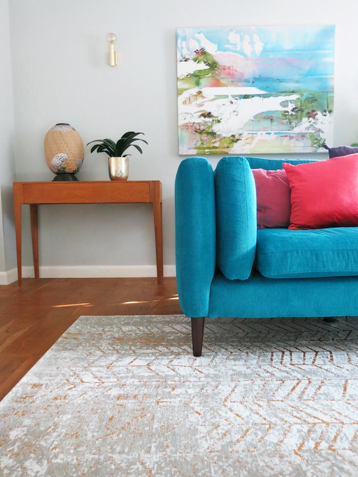 Grey wall teal sofa gold light
