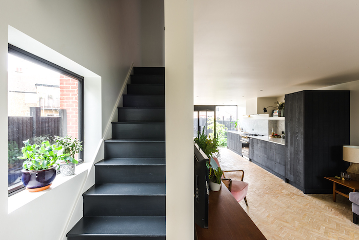stylish painted staircase painted black red brick flooring