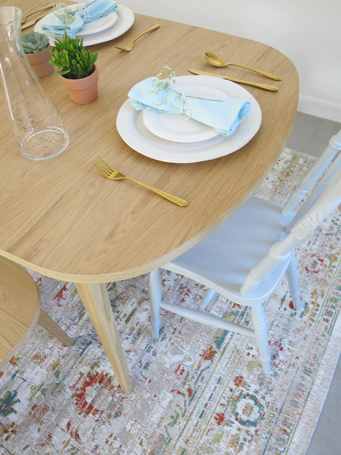 Vintage Style Rug by Louis De Poortere for Under Kitchen Table to add Style and Texture with Painted Grey Chair