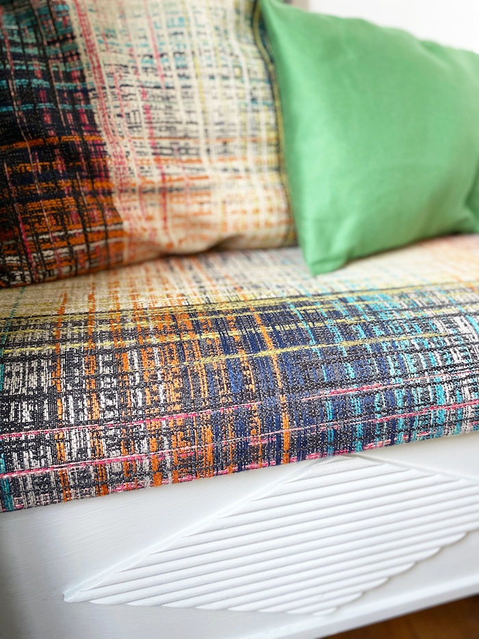 Colourful woven fabric by Harlequin