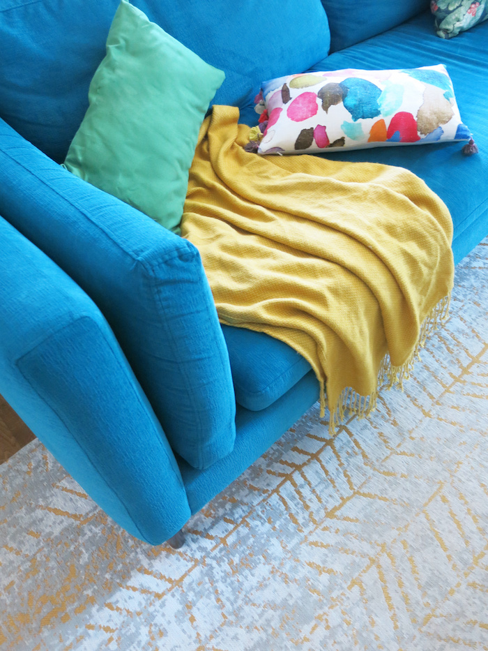 Teal yellow bluebellgray sofa living room
