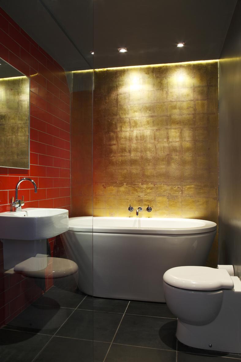 Renovation underground bathroom luxurious reds golds stylish