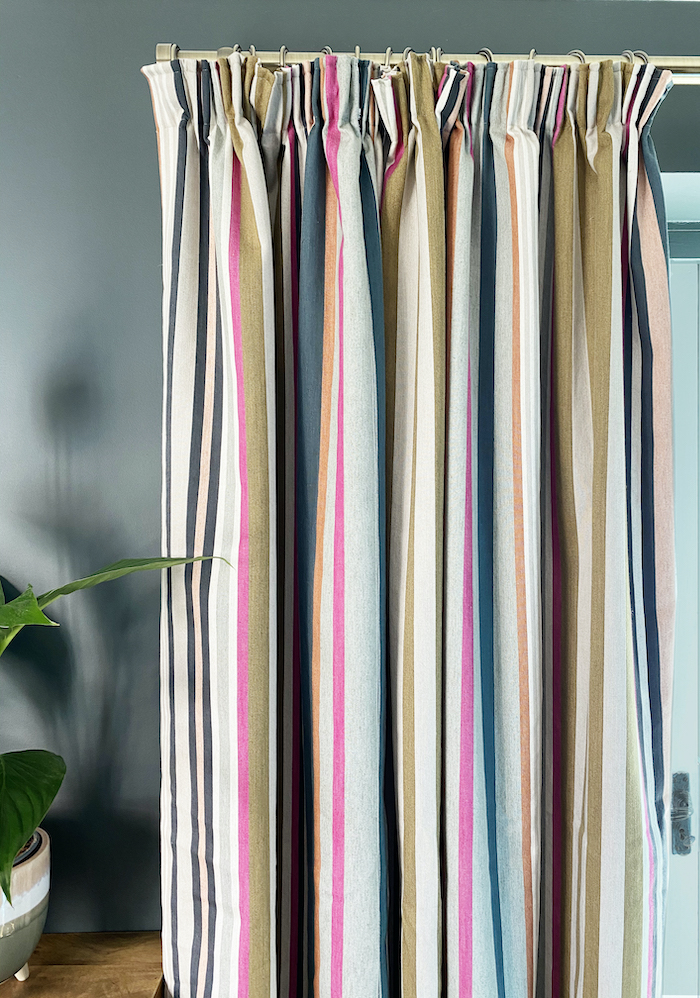 striped curtains with brass pole