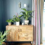 romo striped curtains wooden sideboard